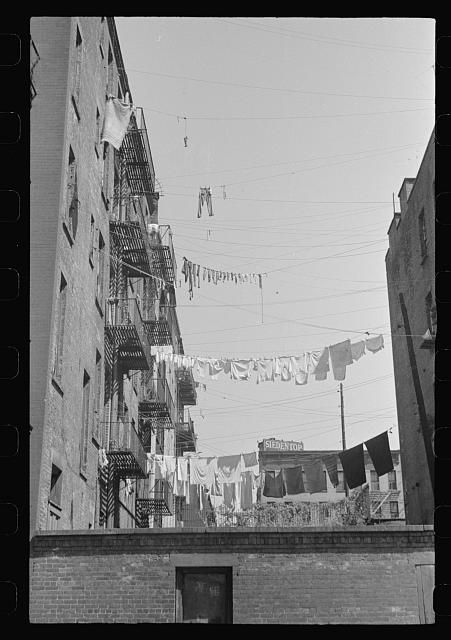 New York, New York. 61st Street between 1st and 3rd Avenues. Apartment houses from the rear