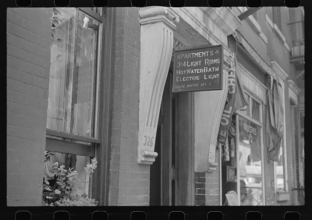 New York, New York. 61st Street between 1st and 3rd Avenues. A sign offering apartments for rent