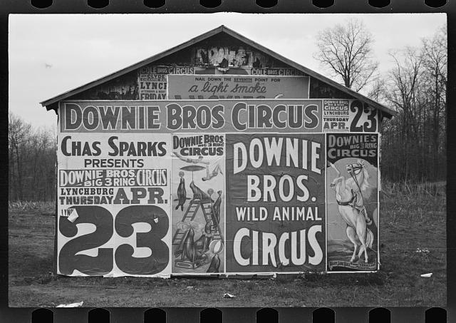 [Posters covering a building near Lynchburg to advertise a Downie Bros. circus]