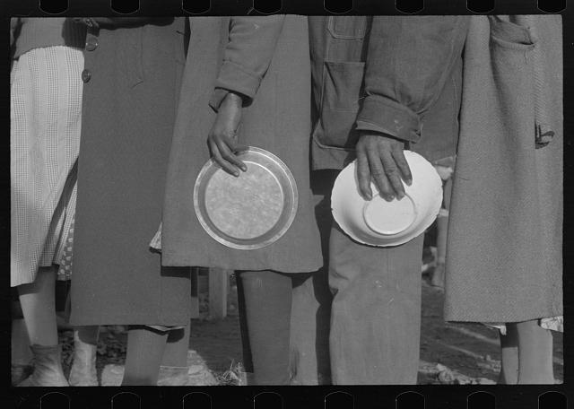 Negroes in the lineup for food at mealtime in the camp for flood refugees, Forrest City, Arkansas