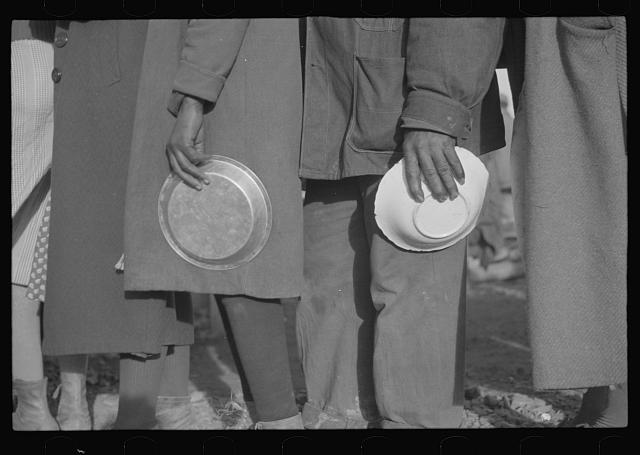 [Untitled photo, possibly related to: Negroes in the lineup for food at mealtime in the camp for flood refugees, Forrest City, Arkansas]