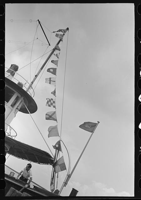 Flags and radio antenna, U.S. Engineer's tug, lower Mississippi River