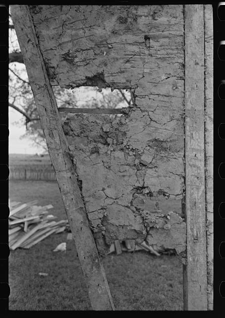 [Untitled photo, possibly related to: Detail of construction of old house; note the wooden cross lath. The construction material composed of mud and native moss. Near Edgard, Louisiana]