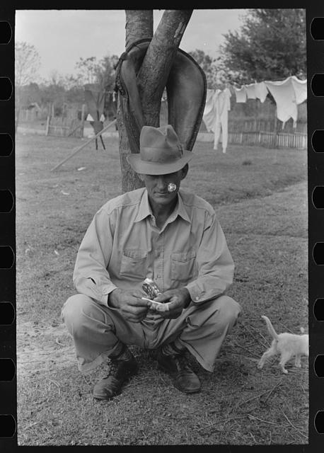 FSA (Farm Security Administration) client, sugarcane farmer, rolling cigarette, near Morganza, Louisiana