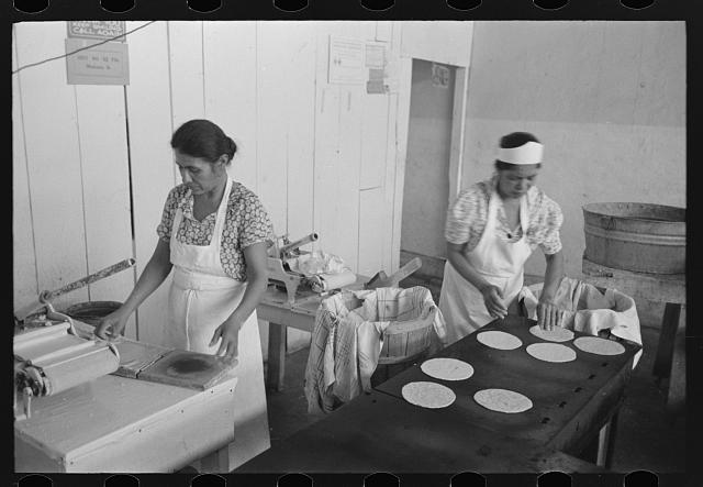 Making tortillas in bake shop, San Antonio, Texas. Tortillas are made of corn flour which is very finely ground and mashed corn. No moisture or baking powder or salt is added