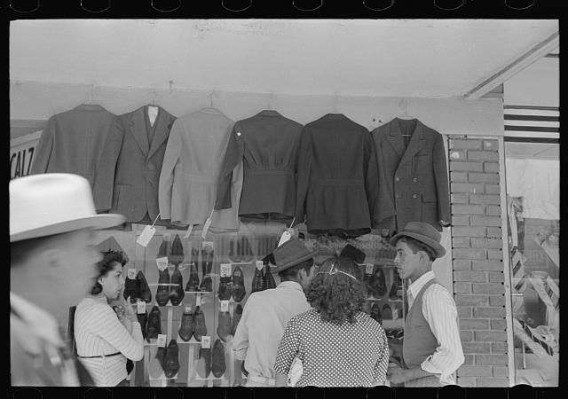 Mexicans looking at suits for sale, San Antonio, Texas