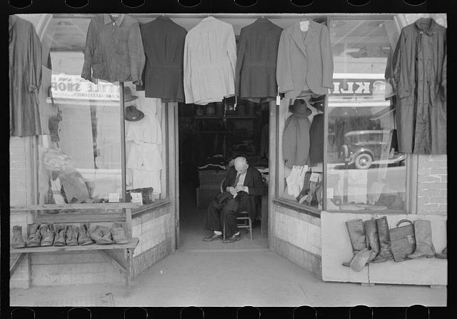 [Untitled photo, possibly related to: Clothing store with tailor in doorway, Mexican district, San Antonio, Texas]