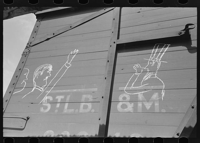Fascism and Uncle Sam sign on box car, Crystal City, Texas