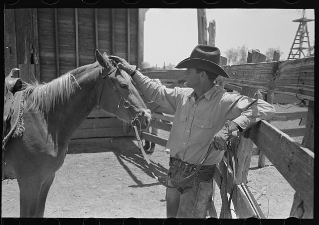 Cowboy petting his horse. Cattle ranch near Spur, Texas