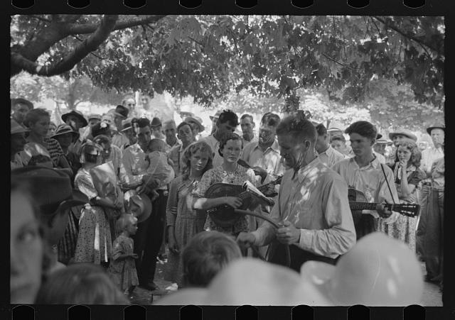 [Untitled photo, possibly related to: Revivalist rally under tree in square, Saturday afternoon, Tahlequah, Oklahoma]