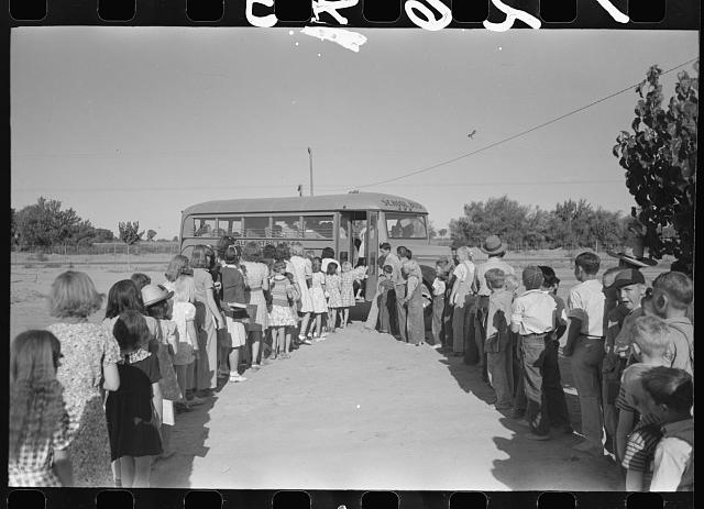 [Untitled photo, possibly related to: Children of migratory laborers who are living at migratory labor camp at Agua Fria, Arizona, boarding school bus]