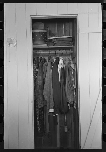 Closet space in apartment of family living and working at the Arizona Part-Time Farms, Chandler Unit, Maricopa County, Arizona