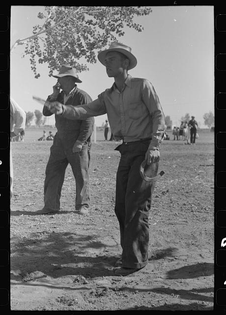 [Untitled photo, possibly related to: Horseshoe pitching contest at the annual field day of the FSA (Farm Security Administration) farmworkers community, Yuma, Arizona]