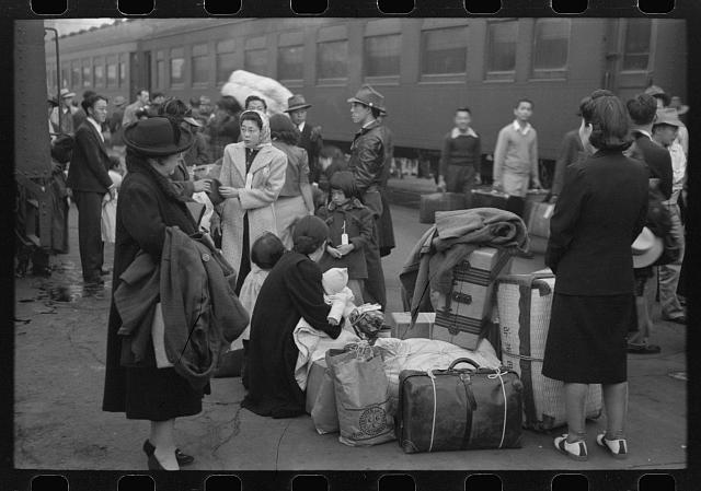 [Untitled photo, possibly related to: Los Angeles, California. Japanese-American evacuation from West Coast areas under U.S. Army war emergency order. Waiting with their luggage at the old Santa Fe station for a train to take them to Owens Valley]