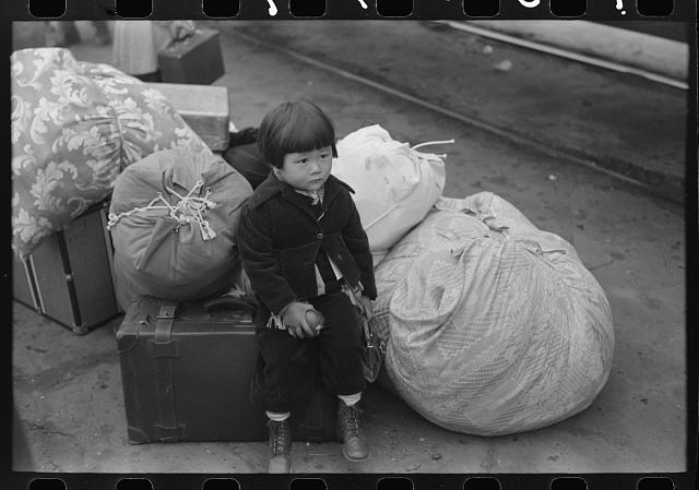 Los Angeles, California. Japanese-American child who is being evacuated with his parents to Owens Valley