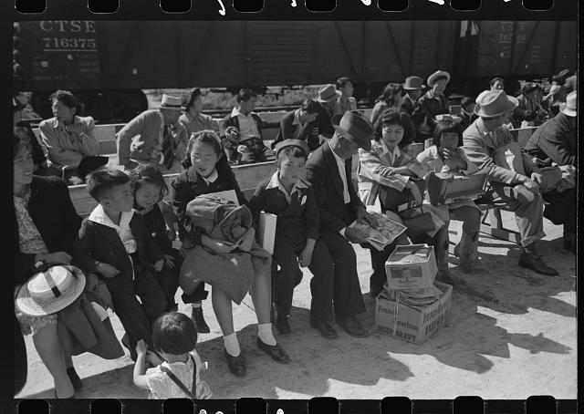 Santa Anita reception center, Los Angeles, California. The evacuation of Japanese and Japanese-Americans from West Coast areas under U.S. Army war emergency order. Waiting for registration