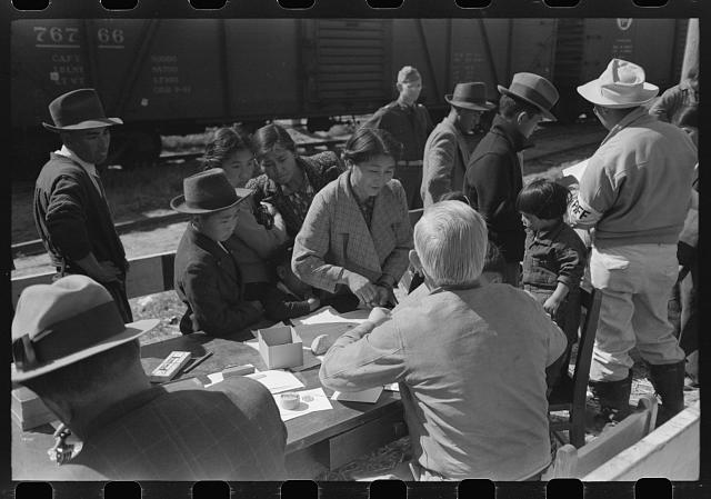 Santa Anita reception center, Los Angeles, California. The evacuation of Japanese and Japanese-Americans from West Coast areas under U.S. Army war emergency order. Registering Japanese-Americans upon arrival