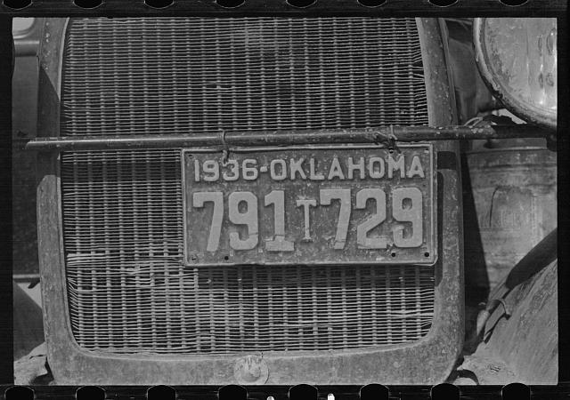 Radiator and license of Oklahoma cotton picker's car. San Joaquin Valley, near Fresno, California