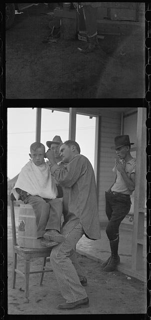 [Untitled photo, possibly related to: Community barber shop in Kern County migrant camp, California]