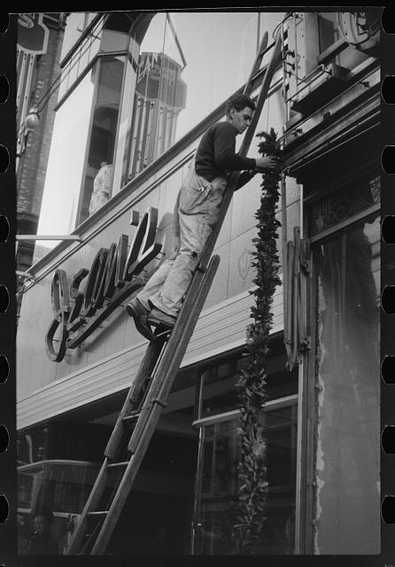 Hanging Christmas decorations in Providence, Rhode Island