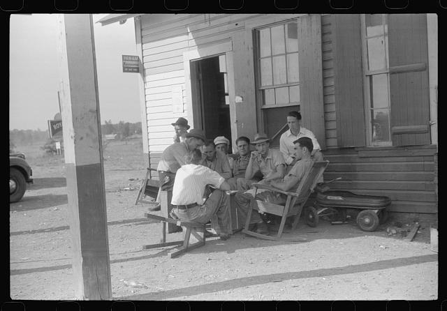 Playing cards at a filling station in Childersburg, Alabama