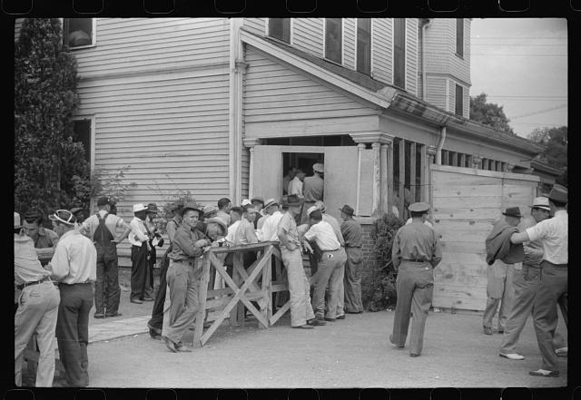 [Untitled photo, possibly related to: Filling out applications for employment at the Du Pont powder plant near Childersburg, at the employment office in Sylacauga, Alabama]