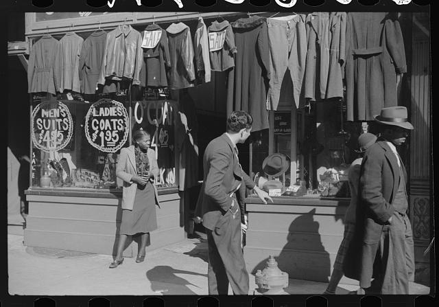 [Untitled photo, possibly related to: Secondhand clothing stores and pawn shops on Beale Street, Memphis, Tennessee]