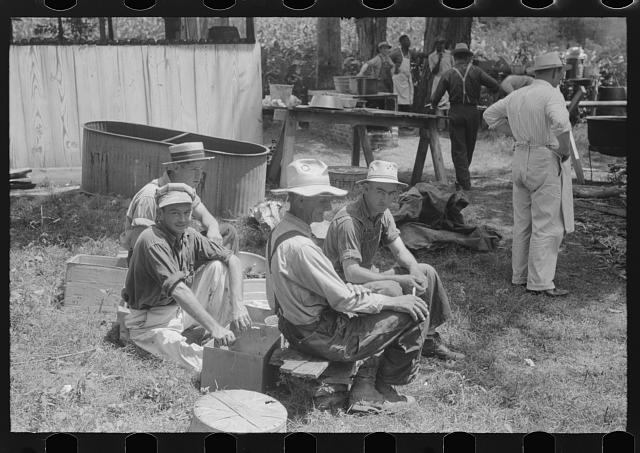 [Untitled photo, possibly related to: Parishoners peeling potatoes for a benefit picnic supper on the grounds of St. Thomas' Church. Near Bardstown, Kentucky]
