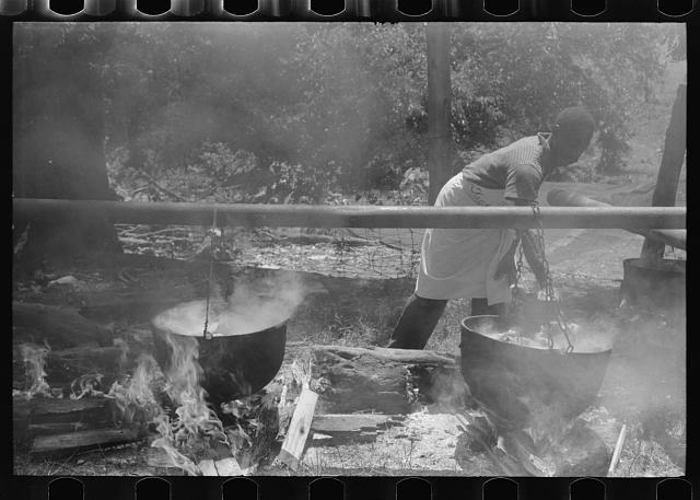 Barbecueing beef and lamb for a benefit picnic supper on the grounds of St. Thomas' Church. Near Bardstown, Kentucky