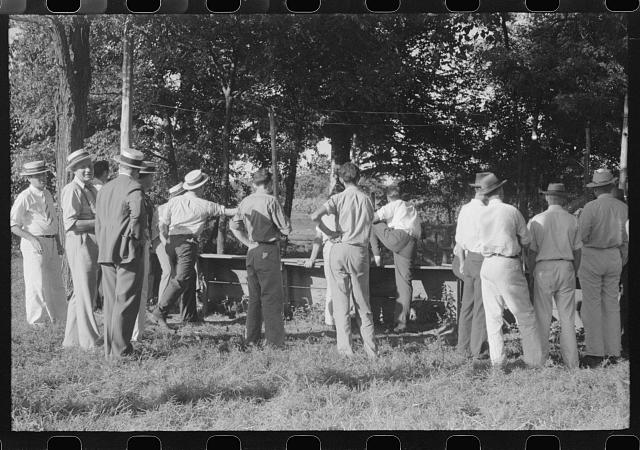 "[Untitled photo, possibly related to: ""Ball-throwing game"" on the grounds of St. Thomas Church at a benefit picnic supper. Near Bardstown, Kentucky]"