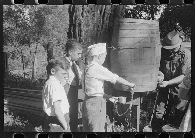 Children getting a drink of water at church picnic at St. Thomas Church, near Bardstown, Kentucky