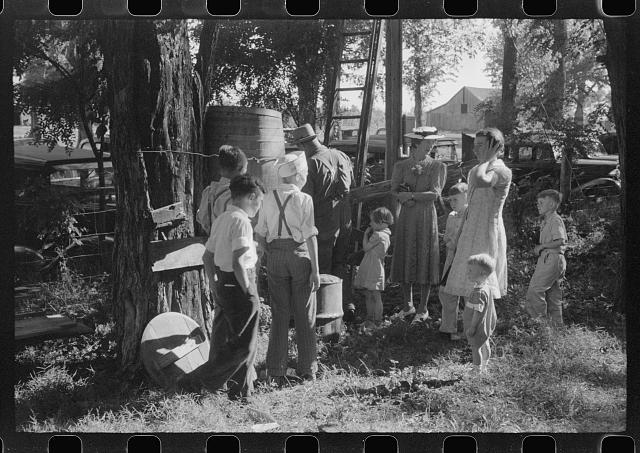 [Untitled photo, possibly related to: Children getting a drink of water at church picnic at St. Thomas Church, near Bardstown, Kentucky]