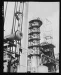 Oil. Oil for our machines of war is supplied by oil refineries like this one. Here are, left to right, the stabilizing, fractionating and heat exchange towers of the McKean cracking plant of the Quaker State Refining Company. Bradford, Pennsylvania