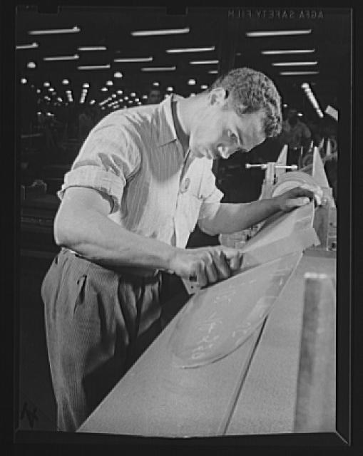 Manpower. Negro aircraft propeller workers. Workers of many racial groups contribute their skills to war production. This Negro worker is checking the size and shape of a propeller blade in a large Eastern airplane propeller factory. Reading the blade with a template requires keen eyes and high precision. Curtiss-Wright Propeller Division. Caldwell, New Jersey