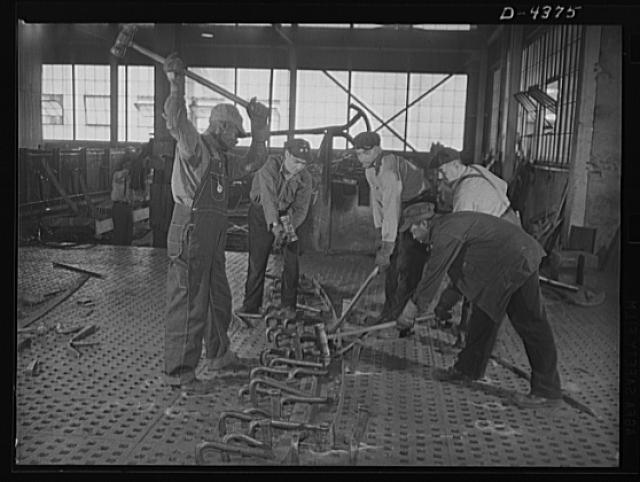 Manpower. Negro shipyard workers. The hammer is still an important tool in ship production. These workers are bending metal fittings on a furnace slab floor, an operation in ship construction at a large Eastern yard. Federal Shipbuilding and Drydock Corporation. Kearny, New Jersey