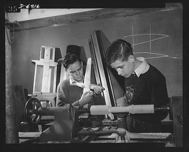 High school Victory Corps. Donald Alman (left) and Melvin E. Lenox, students at McKinley Technical High School, Washington, D.C., build model planes for the Navy's use in training military and civilian personnel. McKinley is one of 6,000 schools throughout the country which provides facilities for pupils to build model planes to Navy specifications