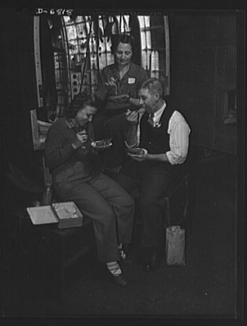 Thanksgiving, 1942. American workers give up the holiday to speed victory. The Blackwelder family celebrated Thanksgiving at their benches in a Glenn Martin Company plant. William P. Blackwelder works in the tool crib of the plane factory, and his wife and daughter are riveters. A son, Frank, in the Navy for one year, has been wounded four times. He has been awarded several medals