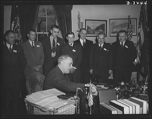 Citation winners. President Roosevelt is shown with the group left to right; Stanley Crawford, certificate winner, RCA Manufacturing Company, Camden, New Jersey; James Merrill, Goodyear Tire and Rubber Company, Akron, Ohio; Daniel W. Mallett, certificate winner, Mechanics Universal Joint Division, Borg-Warner Corporation of Rockford, Illinois; Joseph H. Kautsky, Link-Belt Company of Indianapolis, Indiana, Donald M. Nelson, Chairman of War Production Board (WPB); Madison E. Butler, citation winner, of Strongberg-Carlson Telephone Manufacturing Company, Rochester, New York; and Herbert A. James, certificate winner, Christy Park Works, National Tube Company, McKeesport, Pennsylvania