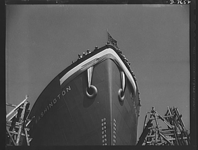 Production. Launching of the SS Booker T. Washington. Shipyard workers of many racial groups which helped construct the SS Booker T. Washington, first Liberty Ship named for a Negro, wave from the deck of the vessel a short time before it was launched at the California Shipbuilding Corporation's yard on September 29, 1942