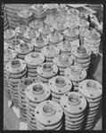 Shipbuilding. Pipes and fittings. Steel pipe flanges in the pipe shop at the Wilmington, California, yard of the California Shipbuilding Corporation. The Booker T. Washington, recently launched at this yard, is one of the many freighters the company has built since Pearl Harbor