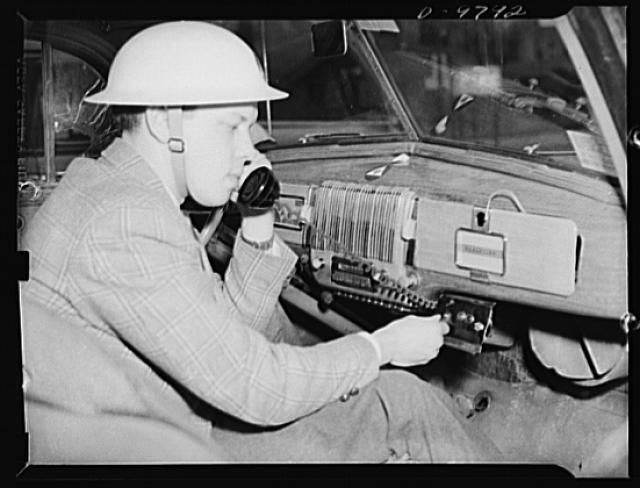 Civilian defense. War Emergency Radio Service. Civilian Defense radio volunteers transformed the auto radio in this auxiliary police car into a a short wave War Emergency Radio Service set, which permits the auxiliary police communications officers to maintain constant two-way contact with his control center