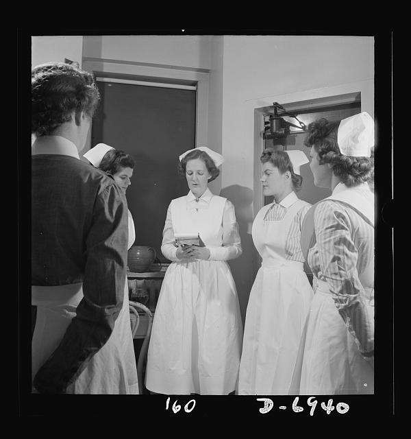 """Nurse training. The """"morning circle"""" starts the day's work for the student nurses. Here students get their assignment and learn what problems must be dealt with on the floor"""