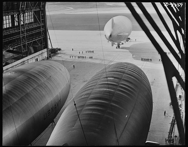 U.S. Navy starts out on patrol duty. A blimp of the U.S. Navy is led onto the apron of an East Coast lighter-than-air station before taking off on a patrol flight over the Atlantic Ocean