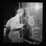 A woman riveter at the Boeing plant in Seattle attaches a sheet of the gleaming outer covering of a fuselage section for a new B-17 F (Flying Fortress) bomber