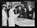 "Wartime food demonstration. Explaining methods of ""extending"" meats now that rationing is limiting civilian meat purchases, wartime food demonstrator Alice Burtis puts finishing touches to a meat loaf before an audience in Washington, D.C."