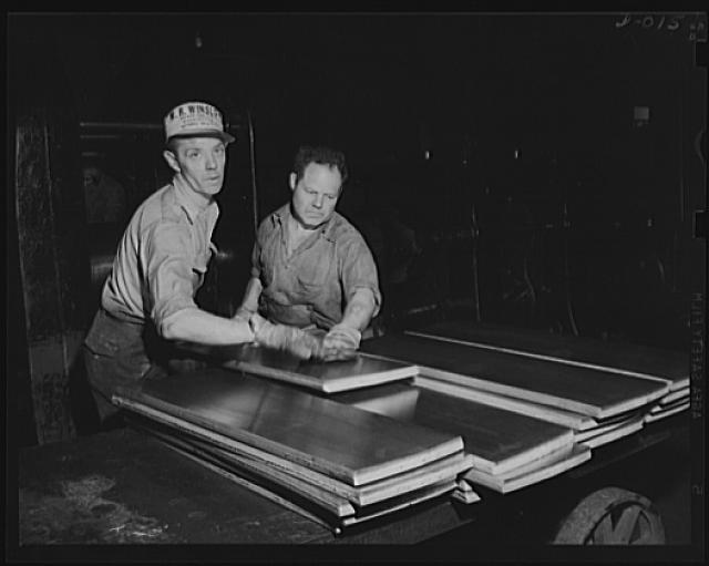 Brass for cartridges. Rolling out brass slabs is one of the first processes in manufacturing cartridge cases. The work is being performed at one of eleven Navy arsenals which are working at top speed to furnish ammunition for our two-ocean Navy