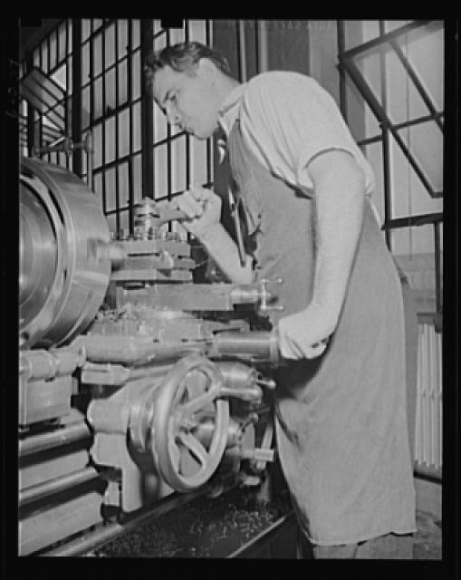 Skilled machine operator. A finishing cut on a turbine wheel in an eastern Navy arsenal where production has been stepped up to top speed to meet war needs