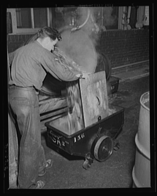 Steam bath for cartridges. Washing 50 caliber cartridge cases between operations at a large eastern arsenal. This plant is working on full shift for war needs