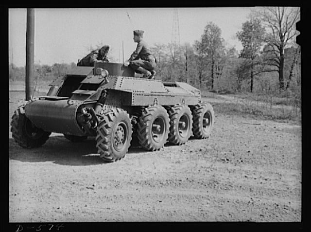 Soldier inspecting new trackless tank during demonstration at Fort Myer, Virginia. For further data see caption for pix D-570