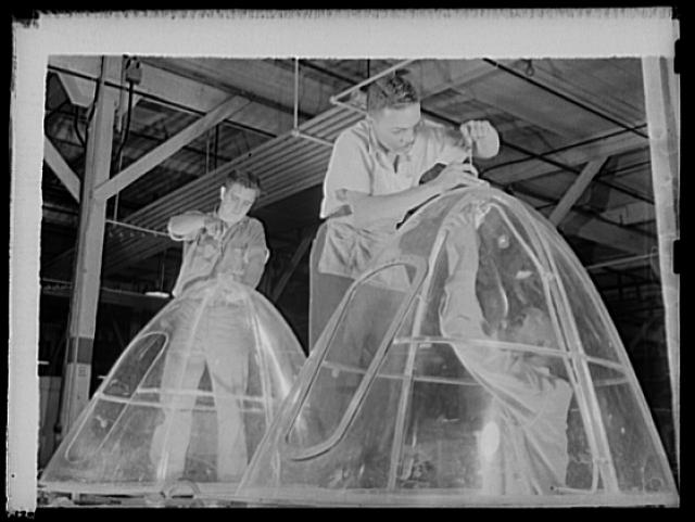 Manpower. Negro bomber plant workers. American manpower draws its skills from various racial groups alike. Here, in a large Eastern bomber plant, huge transparent plastic bomber noses are being conditioned for installation on planes which will carry America's offensive to the far conrers of the world. Glenn L. Martin Bomber Plant. Baltimore, Maryland